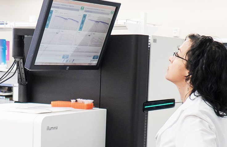 Scientist Looking up at HiSeq